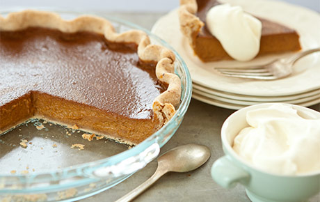 Pumpkin pie with pecan crust and cinnamon-spiced whipped cream
