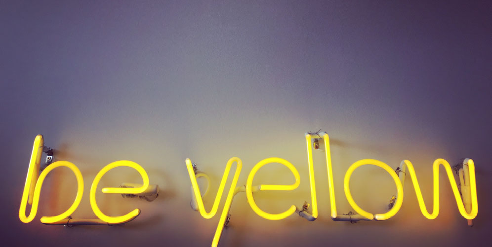 neon sign: be yellow