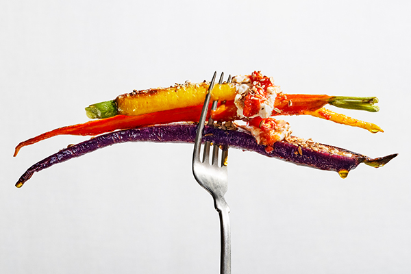 Shot of Harissa Carrots on Fork